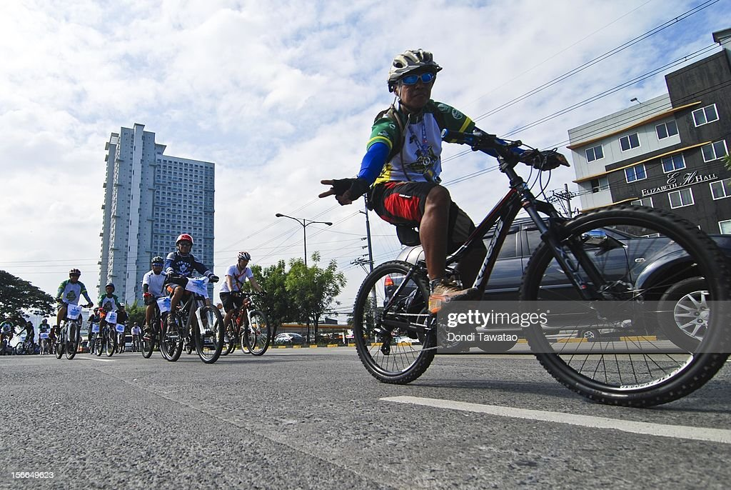 Bikers ride in the streets during the annual Tour of the Fireflies cycling event on November 18, 2012 in Manila, Philippines. The annual event organized by the Firefly Brigade, a cycling group of environmentalists, aims to promote cycling as a sustainable form of transportation in Metro Manila and has become a rite of passage for a growing number of weekend cyclists from all walks of life.