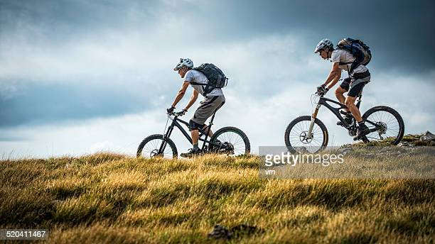 Bikers Riding on a Mountain Trail