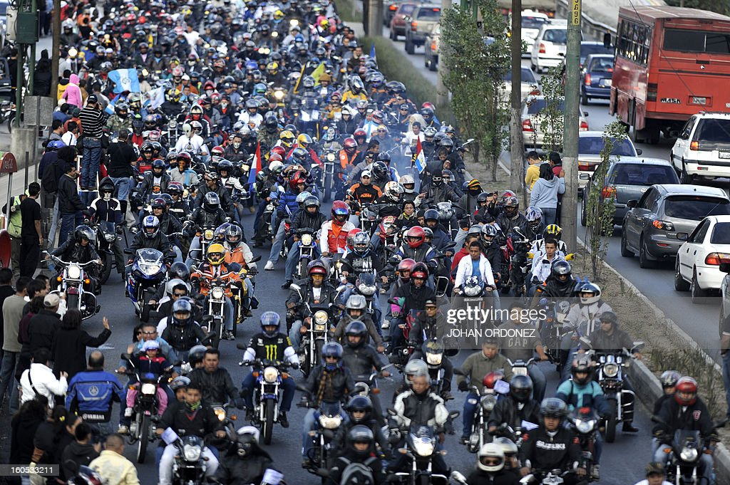 Bikers take part in the 'Caravana del Zorro' (Fox Caravan), going from Constitution Square in Guatemala City towards Esquipulas, 220km eastward, on February 2, 2013. Some 35,000 motorcyclists marched in a pilgrimage to the Cristo Negro (Black Christ) basilic, an already 52-year-old tradition that was declared as Nation heritage. AFP PHOTO/Johan ORDONEZ