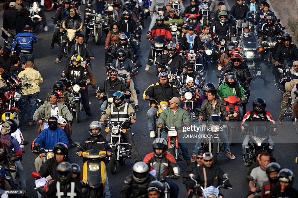 Bikers take part in the 'Caravana del Zorro' (Fox Caravan), going from Constitution Square in Guatemala City towards Esquipulas, 220km eastward, on February 2, 2013. Some 35,000 motorcyclists marched in a pilgrimage to the Cristo Negro (Black Christ) basilic, a tradition already 52-year-old that was declared as Nation heritage. AFP PHOTO/Johan ORDONEZ