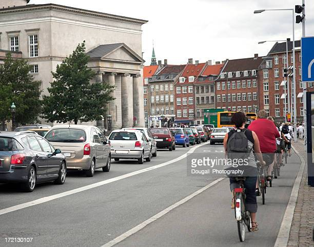 Bikes and Cars During Rush Hour