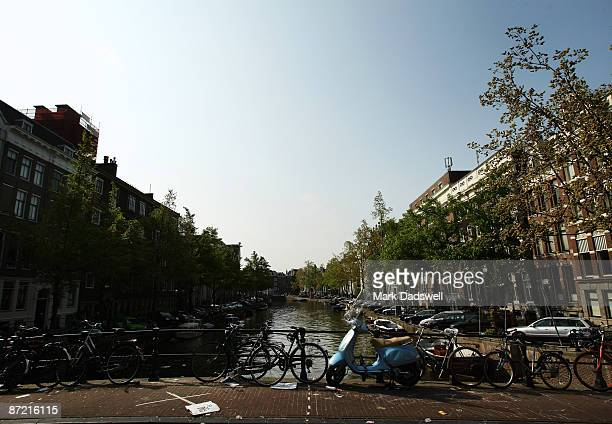 Bikes are chained to a bridge across a canal on May 11 2009 in Amsterdam Netherlands The 750000 people who live in Amsterdam own over 600000 bicycles
