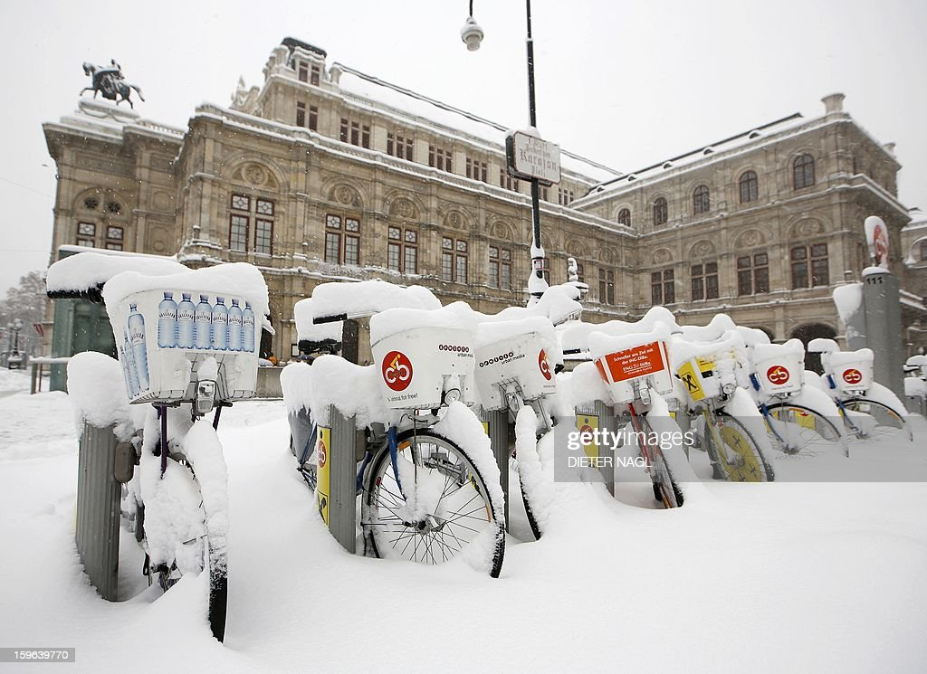 Bikes are covered with snow as heavy snowfall hits Austria on January 17, 2013 in Vienna.
