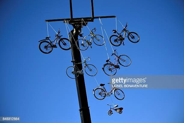Bikes are suspended from a crane during the 1905 km sixth stage of the 103rd edition of the Tour de France cycling race on July 7 2016 between...