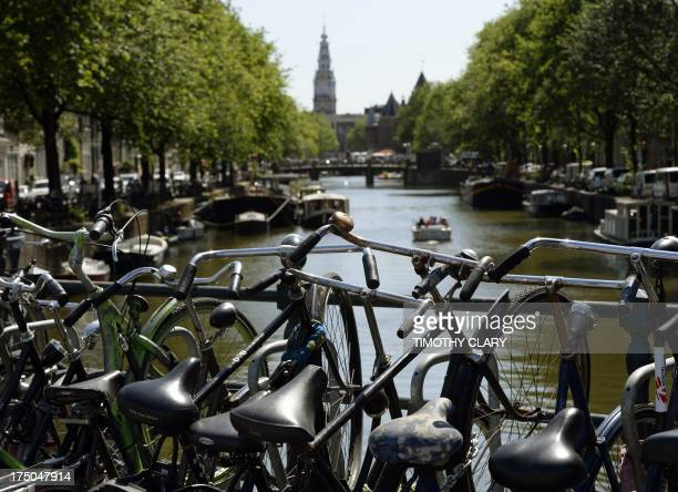 Bikes chained up near one of the many canals in the capitol city of Amsterdam July 16 2013 While recently New York City is introducing a bike share...