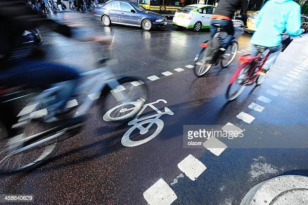Bikes in the city traffic, rush hour