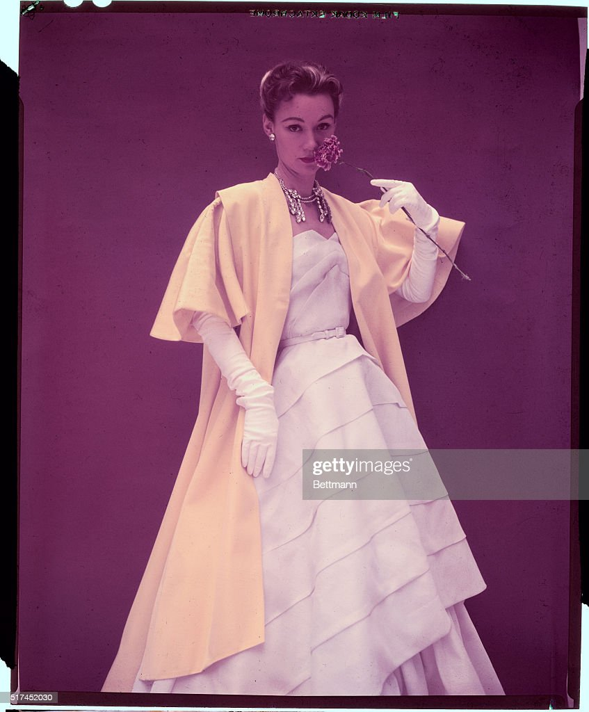 Biki of Milan created her most dramatic evening ensemble in white and brilliant yellow The floor length evening mantle of yellow acetate Gros Grain...