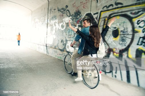 Biking couple in tunnel : Stock Photo
