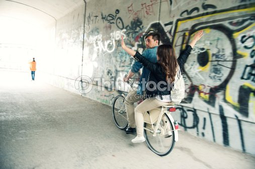 Biking couple in tunnel : Stock Photo