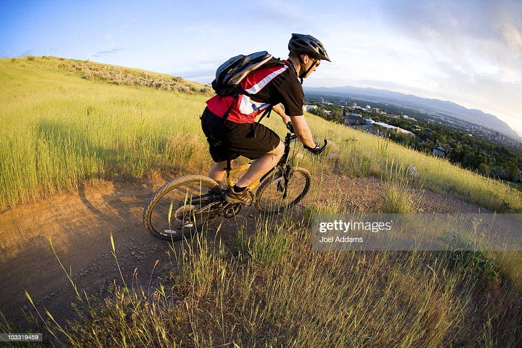 Biking the Shoreline Trail above Salt Lake City, Utah.