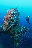 Bikini Atoll, Marshall Islands, Pacific Ocean, scuba diver swimming near propeller of sunken battleship HIJMS Nagato