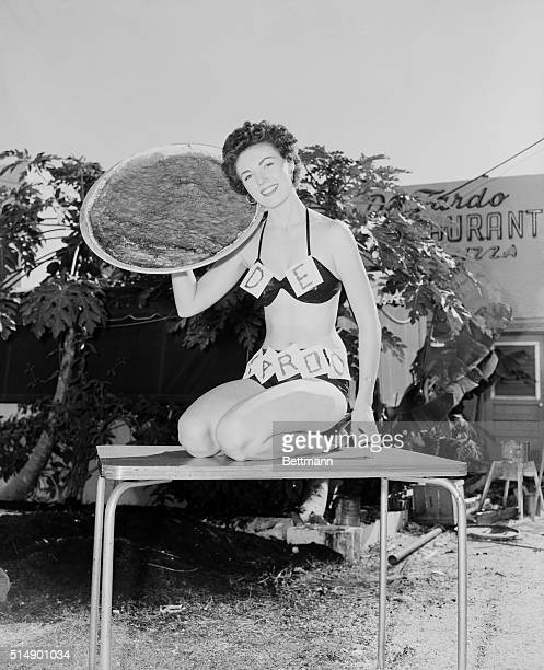 Bikini clad beauties at Miami Beach Florida are now advertising everything from Florida sunshine to pizza pies Here Bunny Yeager does her stint for...