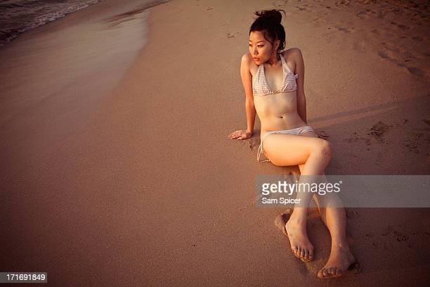 Bikini girl on beach at sunset, Thailand