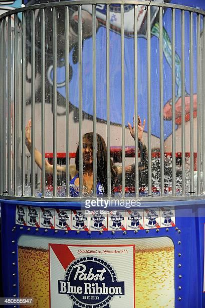 Redhead wearing bikini in dunking booth