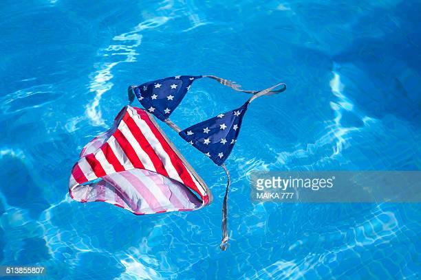 Bikini printed American flag floating in the pool