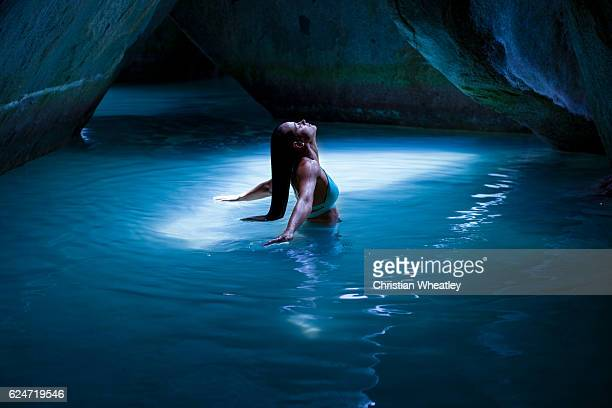 Bikini woman in the cave at the Baths, Virgin Gorda