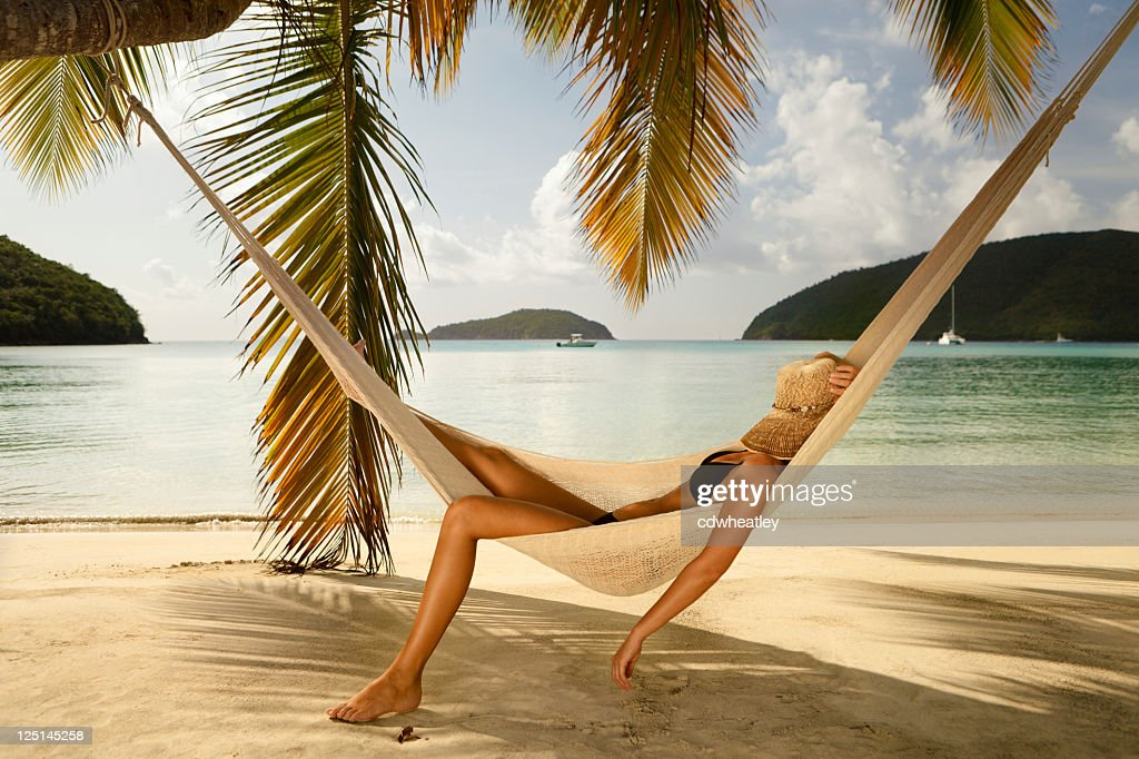 bikini woman napping in a hammock at the Caribbean beach : Stock Photo