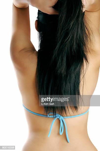 Bikini woman playing with her hair