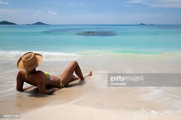 bikini woman relaxing on a beach in Virgin Gorda, BVI