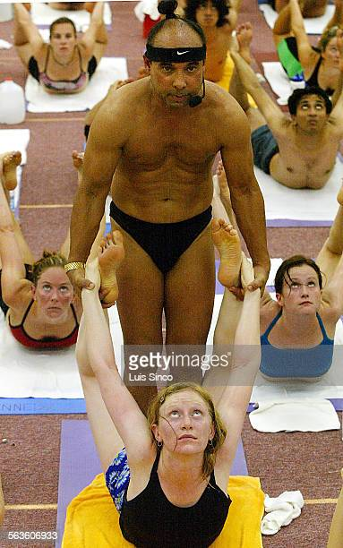 Bikram Choudhury guru and creator of the 26–pose form of hot yoga helps a student at the Bikram Yoga College of India in Los Angeles where devotees...