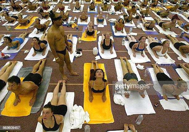 Bikram Choudhury guru and creator of the 26–pose form of hot yoga leads students at the Bikram Yoga College of India in Los Angeles where devotees...