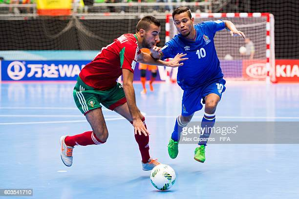 Bilal Bakkali of Morocco and Vassoura fight for the ball during the FIFA Futsal World Cup Group F match between Morocco and Azerbaijan at Coliseo...