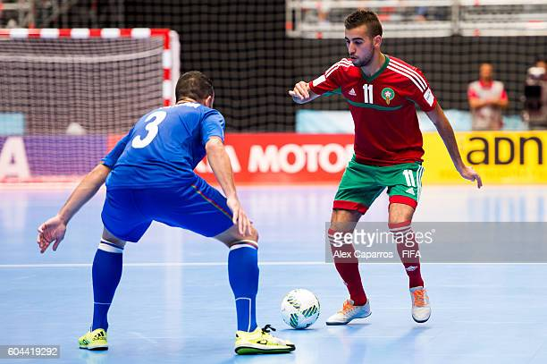 Bilal Bakkali of Morocco challenges Thiago Bolinha of Azerbaijan during the FIFA Futsal World Cup Group F match between Morocco and Azerbaijan at...
