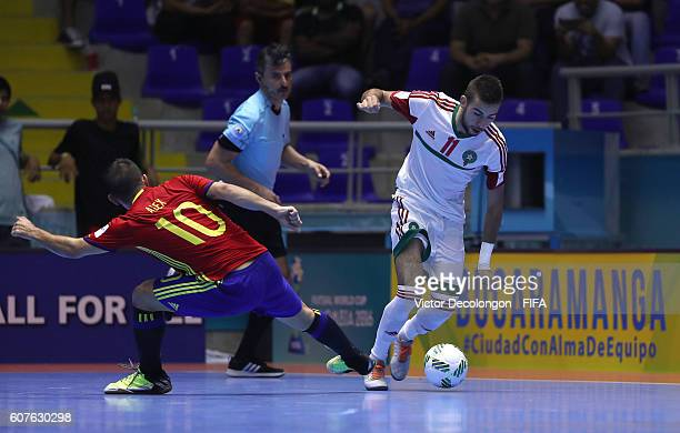 Bilal Bakkali of Morocco plays the ball wide of Alex of Spain during Group F match play between Spain and Morocco in the 2016 FIFA Futsal World Cup...