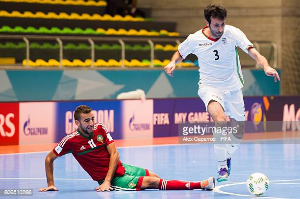 Bilal Bakkali of Morocco tackles Ahmad Esmaeilpour of Iran during the FIFA Futsal World Cup Group F match between Iran and Morocco at Coliseo Ivan de...