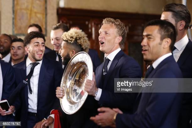 Bilal Basacikoglu of Feyenoord Tonny Vilhena of Feyenoord Dirk Kuyt of Feyenoord coach Giovanni van Bronckhorst with tropheeduring Feyenoord...