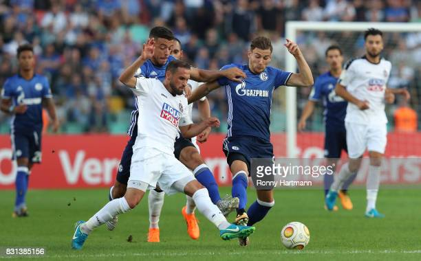 Bilal Cubukcu of Berlin vies with Franco di Santo and Leon Goretzka of Schalke during the DFB Cup first round match between BFC Dynamo and FC Schalke...