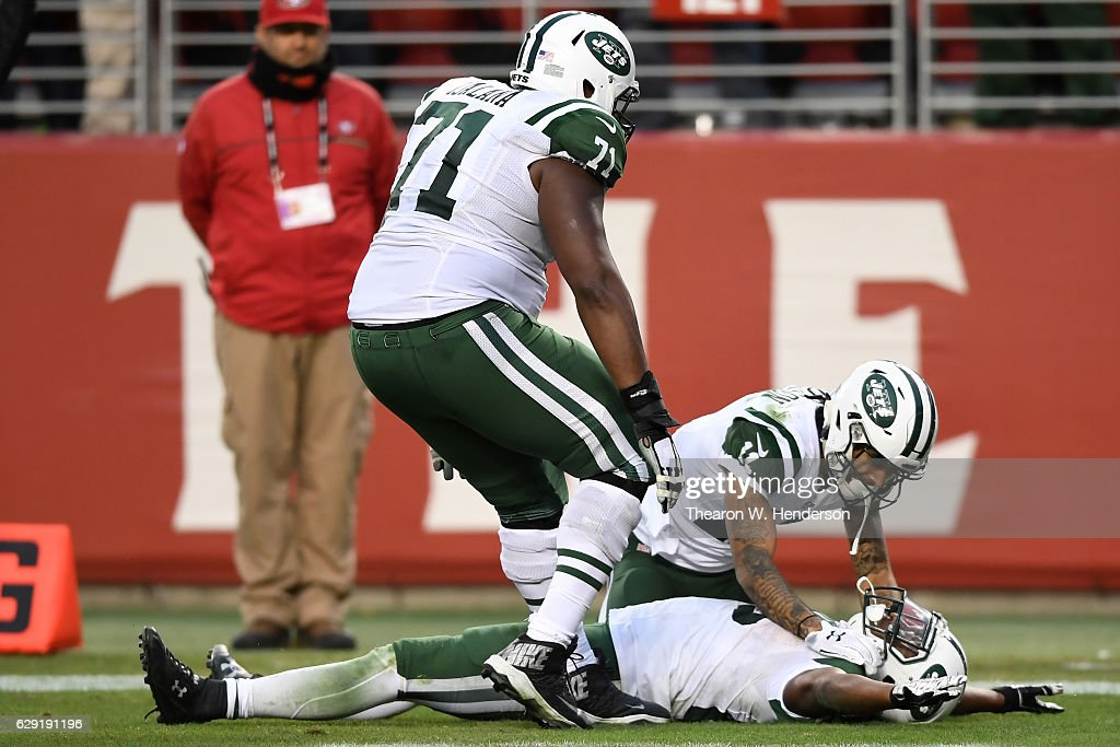 Bilal Powell #29 of the New York Jets celebrates with teammates after scoring the game winning touchdown in overtime to beat the San Francisco 49ers 23-17 in their NFL game at Levi's Stadium on December 11, 2016 in Santa Clara, California.
