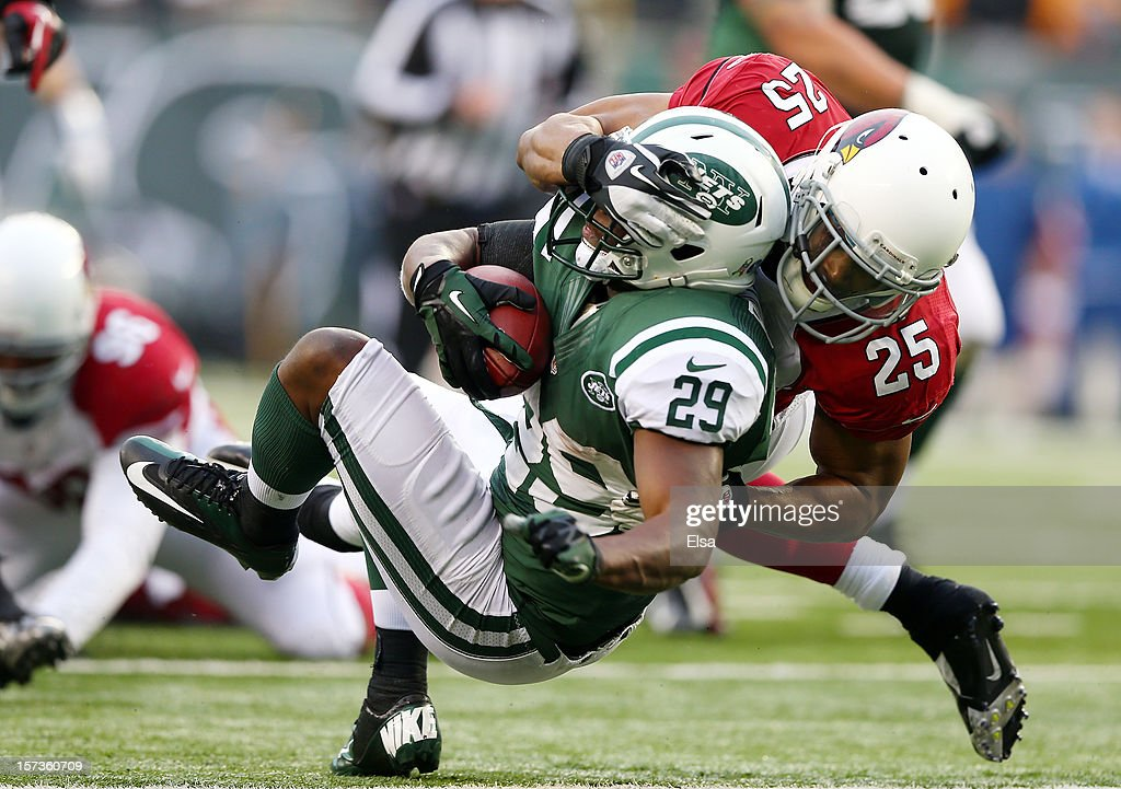 <a gi-track='captionPersonalityLinkClicked' href=/galleries/search?phrase=Bilal+Powell&family=editorial&specificpeople=4671561 ng-click='$event.stopPropagation()'>Bilal Powell</a> #29 of the New York Jets is tackled by <a gi-track='captionPersonalityLinkClicked' href=/galleries/search?phrase=Kerry+Rhodes&family=editorial&specificpeople=567200 ng-click='$event.stopPropagation()'>Kerry Rhodes</a> #25 of the Arizona Cardinals on December 2, 2012 at MetLife Stadium in East Rutherford, New Jersey. The New York Jets defeated the Arizona Cardinals 7-6.