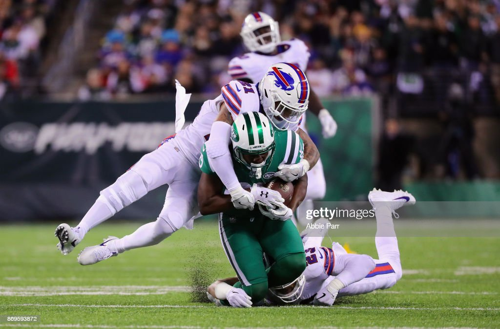 Bilal Powell #29 of the New York Jets is taken down by Micah Hyde #23 and Jordan Poyer #21 of the Buffalo Bills during the third quarter of the game at MetLife Stadium on November 2, 2017 in East Rutherford, New Jersey.