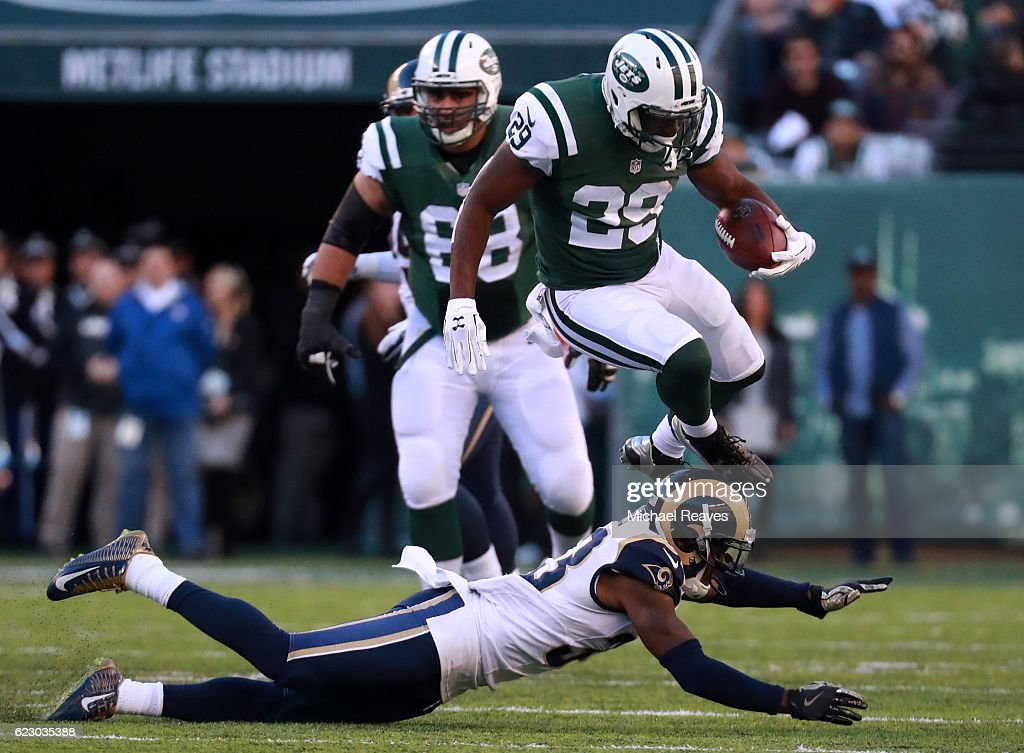 Bilal Powell #29 of the New York Jets leaps over E.J. Gaines #33 of the Los Angeles Rams in the second quarter at MetLife Stadium on November 13, 2016 in East Rutherford, New Jersey.
