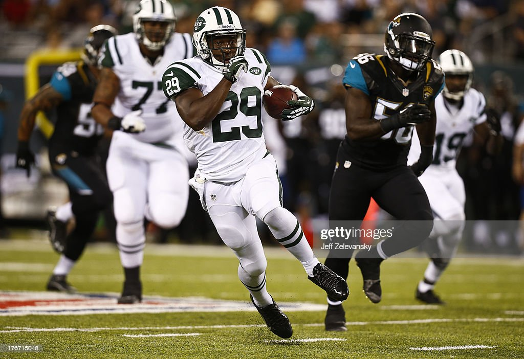 Bilal Powell #29 of the New York Jets runs the ball against the Jacksonville Jaguars during their preseason game at MetLife Stadium on August 17, 2013 in East Rutherford, New Jersey.
