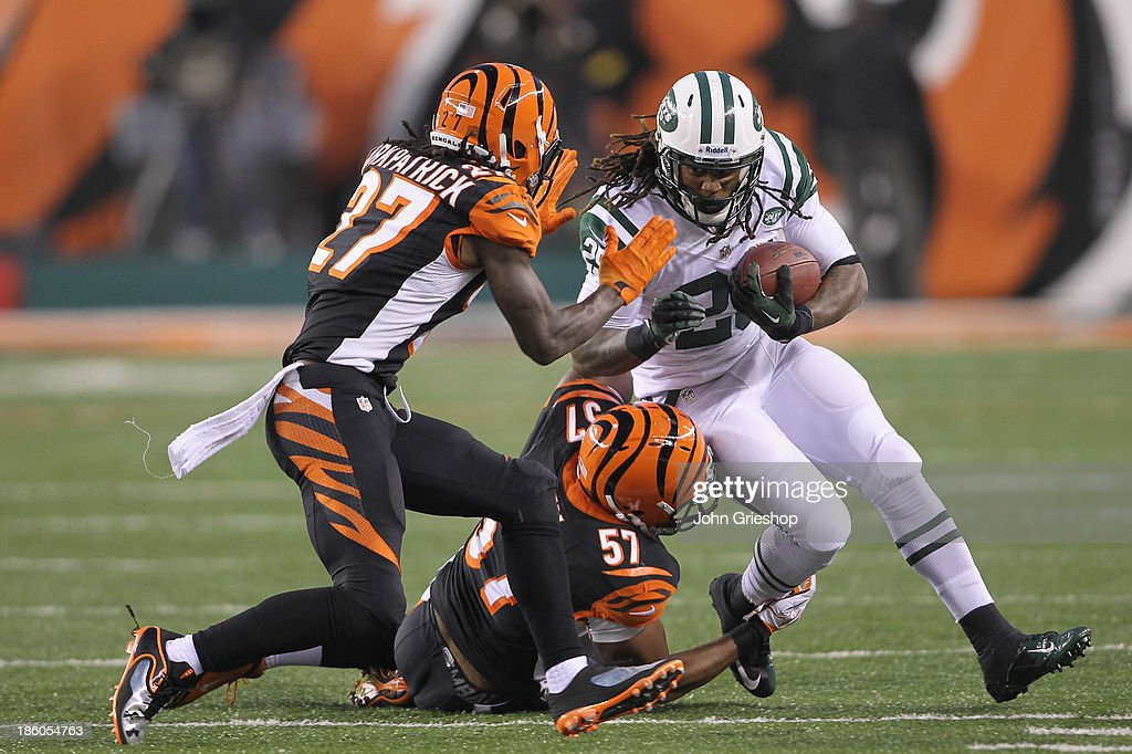 <a gi-track='captionPersonalityLinkClicked' href=/galleries/search?phrase=Bilal+Powell&family=editorial&specificpeople=4671561 ng-click='$event.stopPropagation()'>Bilal Powell</a> #29 of the New York Jets runs the ball upfield against <a gi-track='captionPersonalityLinkClicked' href=/galleries/search?phrase=Vincent+Rey&family=editorial&specificpeople=4617572 ng-click='$event.stopPropagation()'>Vincent Rey</a> #57 and <a gi-track='captionPersonalityLinkClicked' href=/galleries/search?phrase=Dre+Kirkpatrick&family=editorial&specificpeople=6699002 ng-click='$event.stopPropagation()'>Dre Kirkpatrick</a> #27 of the Cincinnati Bengals during their game at Paul Brown Stadium on October 27, 2013 in Cincinnati, Ohio. The Bengals defeated the Jets 49-9.