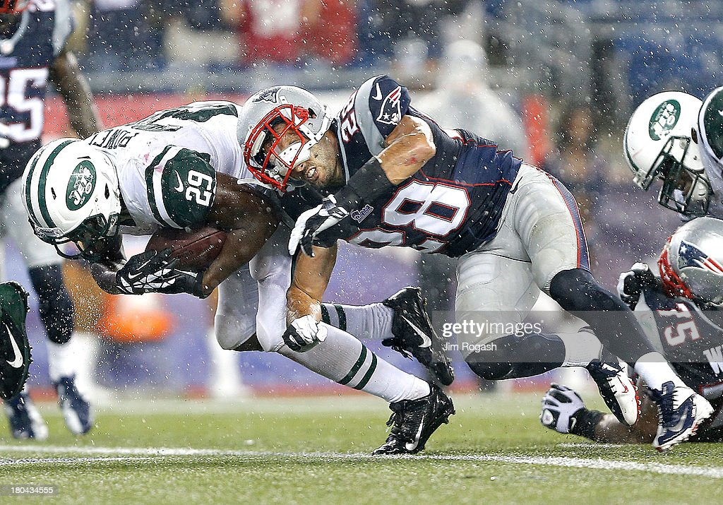 <a gi-track='captionPersonalityLinkClicked' href=/galleries/search?phrase=Bilal+Powell&family=editorial&specificpeople=4671561 ng-click='$event.stopPropagation()'>Bilal Powell</a> #29 of the New York Jets scores a touchdown as Steve Gregory #28 of the New England Patriots defends in the second half at Gillette Stadium on September 12, 2013 in Foxboro, Massachusetts.