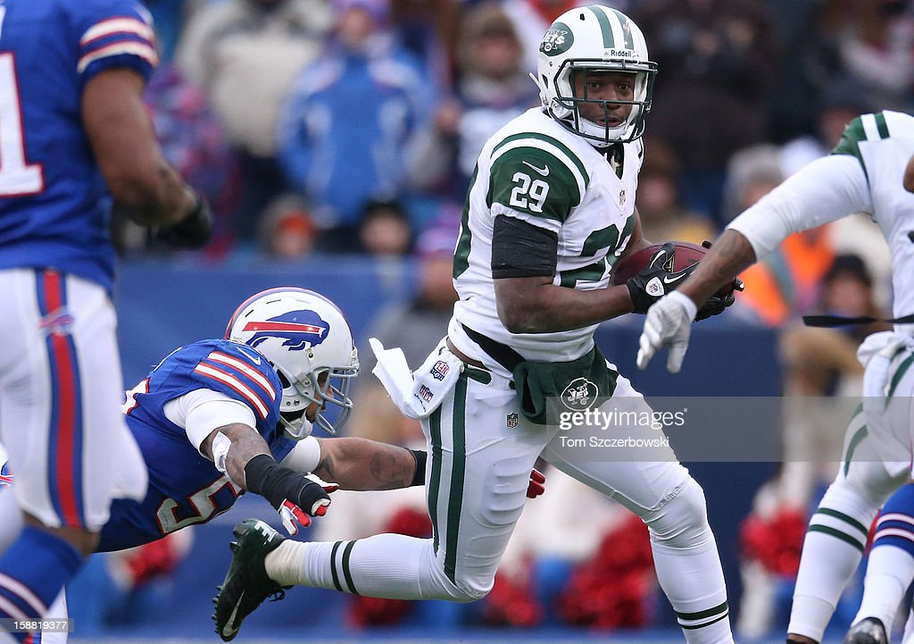Bilal Powell #29 of the New York Jets tries to escape a tackle by Nick Barnett #50 of the Buffalo Bills during an NFL game at Ralph Wilson Stadium on December 30, 2012 in Orchard Park, New York.