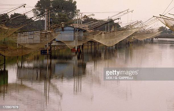 Bilancioni fishing nets that are lowered from strange wooden scaffolding on the river banks Valli di Comacchio valley Po Delta Regional Park...