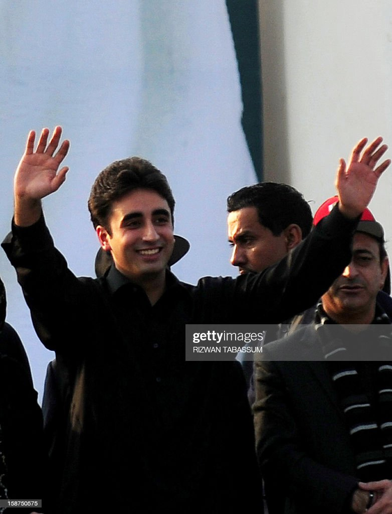 Bilawal Bhutto, son of assassinated former Pakistani premier Benazir Bhutto, and chairman of ruling Pakistan People's Party (PPP) waves to supporters outside the Bhutto family mausoleum in Garhi Khuda Bakhsh on December 27, 2012, on the fifth anniversary of the assassination of Benazir Bhutto. The son of Pakistan's slain former prime minister Benazir Bhutto launched his political career on the anniversary of his mother's death with an attack on the country's judiciary. More than 200,000 people gathered at the Bhutto family mausoleum in Garhi Khuda Bakhsh in the southern province of Sindh to pay their respects to Benazir and to hear Bilawal Bhutto Zardari make his first major public speech.