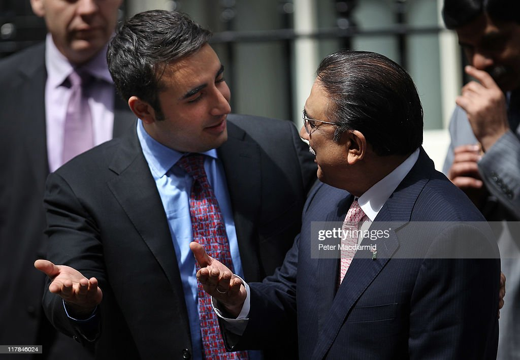 Bilawal Bhutto (L) tries to persuade his father President Zardari of Pakistan to talk to reporters in Downing Street on July 1, 2011 in London, England. Mr Zardari is in London on a two day visit to discuss enhancing UK-Pakistan partnership in trade and investment.