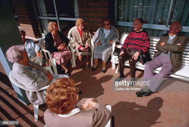 Bilbao Spain Group of pensioners chatting in his old age home