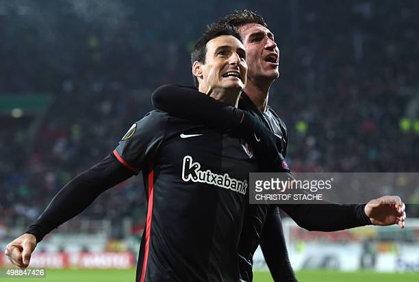 Bilbao's striker Aritz Aduriz and Bilbao's French defender Aymeric Laporte celebrate scoring during the UEFA Europa League football match FC Augsburg...