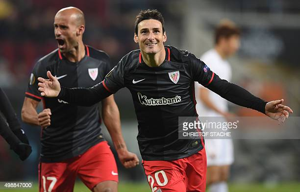 Bilbao's striker Aritz Aduriz celebrate after scorimg the second goal with midfielder Mikel Rico during the UEFA Europa League football match FC...