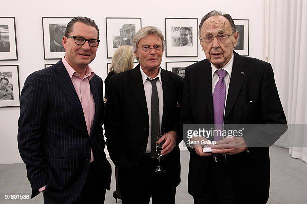 Bild newspaper editorinchief Kai Diekmann former German foreign minister HansDietrich Genscher and photographer Konrad R Mueller attend the 'Die 8...