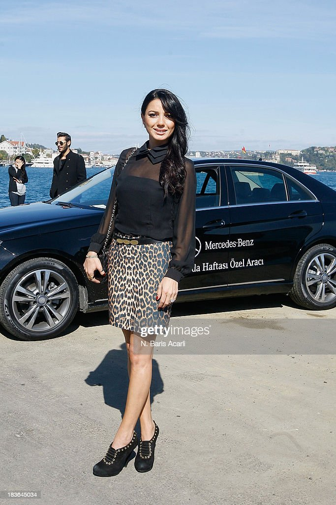 Bilge Karadeniz wears an Enmoda.com skirt, a Homestore top, a Chanel bag and Dior shoes during Mercedes-Benz Fashion Week Istanbul s/s 2014 presented by American Express on October 7, 2013 in Istanbul, Turkey.