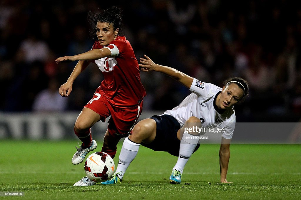 Bilgin Defterli of Turkey holds off the challenge of Lucy Bronze of England during the FIFA Women's World Cup 2015 Group 6 Qualifier match between England and Turkey at Fratton Park on September 26, 2013 in Portsmouth, England.