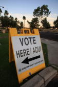 A bilingual sign announces a polling place in the home state of Republican presidential nominee US Sen John McCain November 4 2008 in Phoenix Arizona...