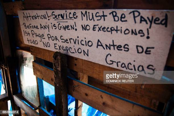 A bilingual sign describing terms of service is seen at a heroin encampment in the Kensington neighborhood of Philadelphia Pennsylvania on April 10...